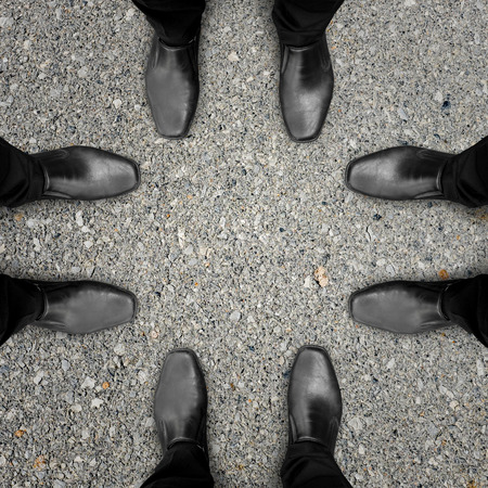 slack: Four businessmen in black shoes are meeting and talking about global business, cooperation and partnership
