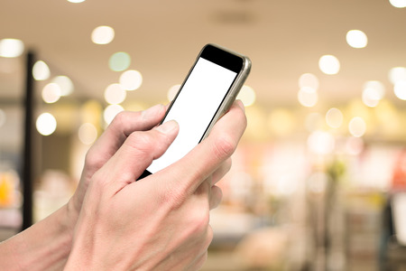 departmentstore: One using smartphone in shopping mall with bokeh background