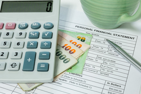 financial statement: Personal financial statement document, pen, coffee cup, money bill and calculator