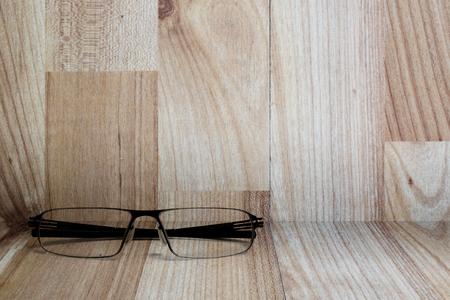 the shelf: Eye glasses on wooden shelf Stock Photo