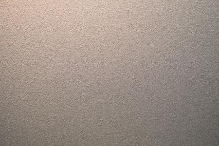 La lumière du soleil brille à travers la texture de verre dépoli gris comme arrière-plan - design d'intérieur et décoration Banque d'images