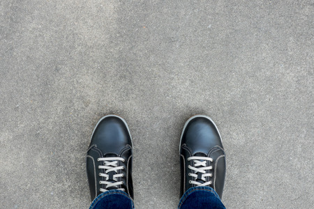 floor standing: Black casual shoes standing on the concrete floor Stock Photo
