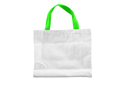 Isolated reuseable white clothe bag with green handle