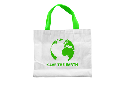 Isolated reuseable white fabric bag with green handle and SAVE THE EARTH on the bag. Environment saving issue.