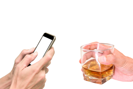 departmentstore: One offer a glass of whiskey for celebration but another one only playing his smartphone and does not care about celebration and party