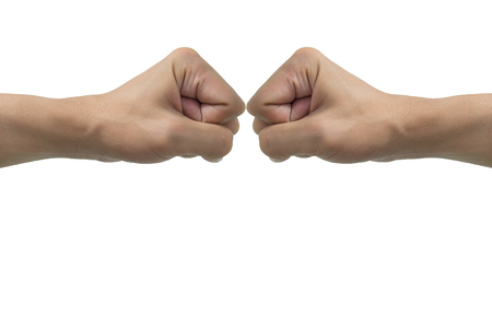 Isolated fist hands bumping on white background. Representing friend, enemy, fight, deal, rival, competitor, conflict, etc.