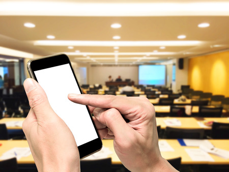 one on one meeting: One playing smartphone in conference meeting room. Global conference communication. Global business meeting.