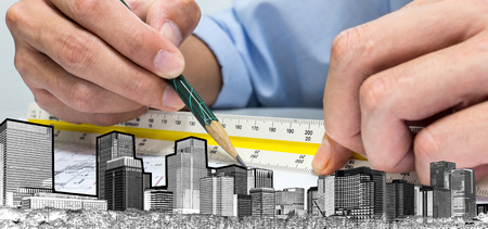 quantity surveyor: engineer are measuring distance in drawing using pencil and ruler building whole world. Calculate and design for building and tower in the city. Stock Photo