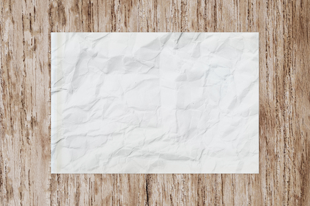 creased: White blank crumpled paper on wooden table, creased paper texture for background Stock Photo
