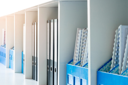 office cabinet: White office document cabinet, shelf and blue document boxes Stock Photo