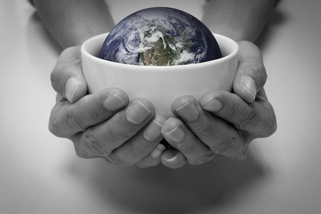 starvation: Hungry people and the earth in white ceramic bowl. Conceptual saving earth, saving environment, earth care, people care, help and share, starvation and hungry people.