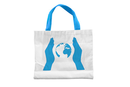 Isolated reuseable white fabric bag with blue handle and SAVE THE EARTH on the bag. Environment saving issue.