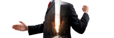 business for the middle: Multiple exposure of businessmen and city. Left man offer handshake for business deal. Right man raising his fist of success. In the middle is cityscape, tower, street in the sunlight.