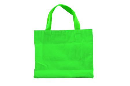 reuseable: Isolated reuseable green fabric bag for environment conservation campaign and for shopping.