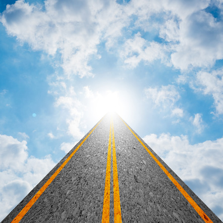 leading light: Road leading to the cloudy sky and the sun shining bright light at the end of the road. Representing success, religion, holy, faith, belief, spiritual concept