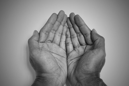 monotone: Monotone opened hands begging hands. Representing the poor, hungry, hunger, starvation, mercy, help and hope.