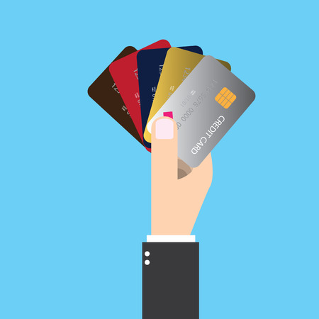 Isolated businessman holding five credit card in his right hand. To pay future money buying something by making dept.
