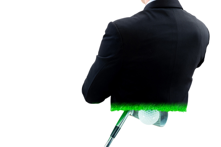 double game: Double exposure of back side of businessman in dark suit crossing ones arm and golf iron club with golf ball for practice. Stock Photo