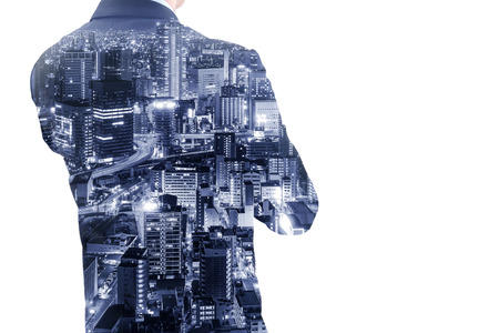 Double exposure businessman crossing one arm thinking about business and future and Osaka city at night.