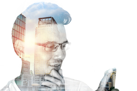 near sighted: Double exposure man wearing eyeglasses using smartphone with smile and happy and downtown city. Stock Photo