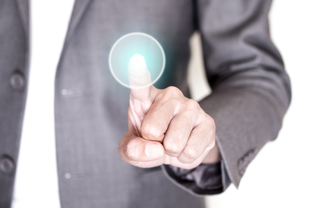 begin: Businessman in gray suit pushing on round transparent button.