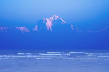Thailand sea and Himalaya mountains manipulated as mysterious island for background. Stock Photo