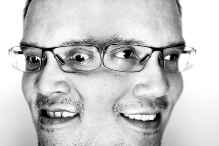 nearsighted: Two emotion face of a man. One is happy with smile, another in angry and mad.