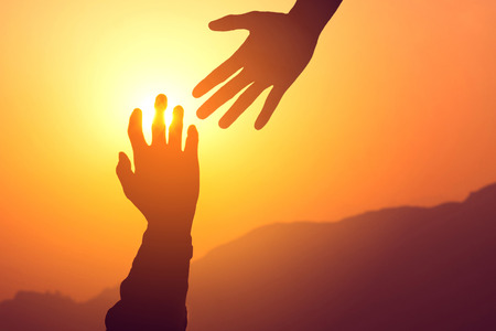 Helping hands concept. Silhouette of hands help and hope and support each other.