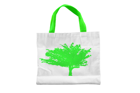 Isolated reuseable green tree fabric bag for environment conservation campaign and for shopping. Stock Photo