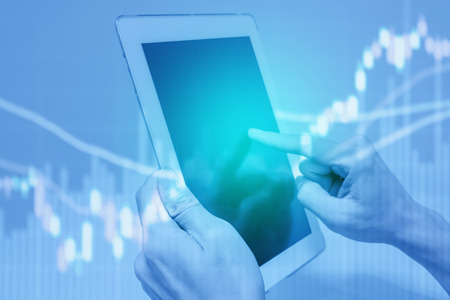 One using tablet pc for business and economic data analysis and stock trading.