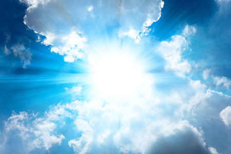 Abstract cloudy blue sky with sun light burst for background.