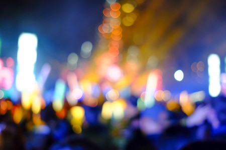 Abstract blur crowded people watching concert, singing and dancing and feeling enjoy and fun.