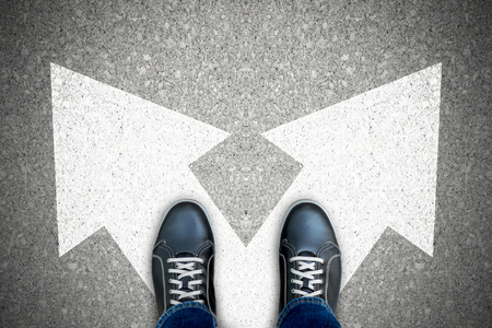 One standing at the crossroad making decision which way to go. Banque d'images