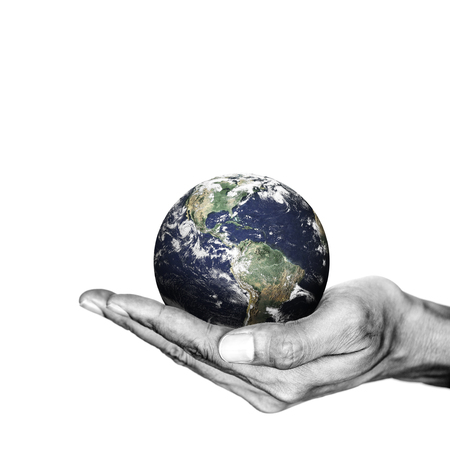Isolated opened hand and the earth on white background. Environment saving concept.