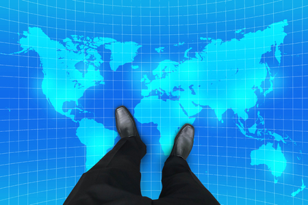 Business concept global business. Businessman standing on world map.