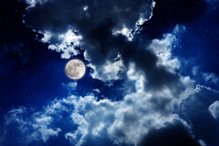 The moon with cloudy night sky with shiny stars for background. Imagens