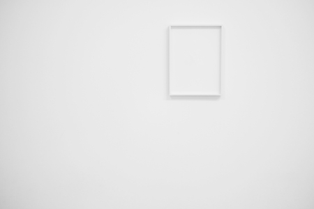 Empty white frame on white wall for interior decoration. Minimal concept.