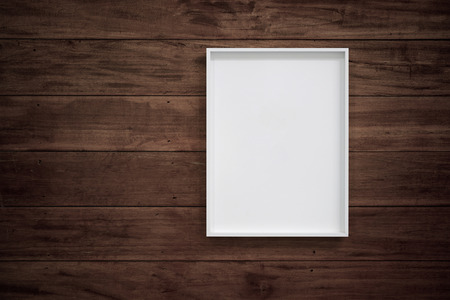 Empty white frame on wooden wall for interior decoration. Minimal concept.