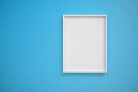Empty white frame on blue concrete wall for interior decoration. Minimal concept.