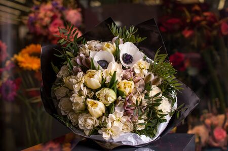 Beautiful Bouquet. Spring flowers in the cold dark room of the flower shop