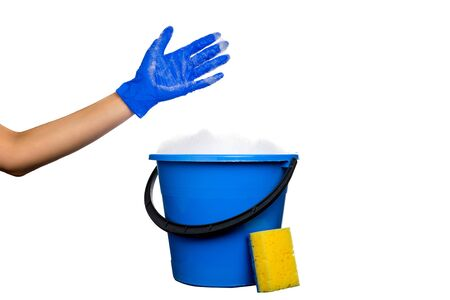 Plastic blue water bucket with soapsuds and black handle. Cleaning Products and Supplies. Gloved hand with soap suds. Isolated white background