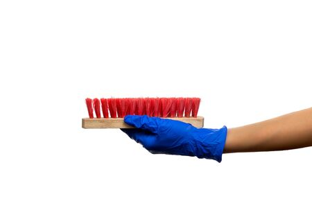 Hand in a blue glove with red cleaning brush. Cleaning Products and Supplies.