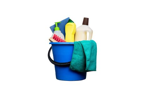 Plastic blue water bucket with black handle, brush, sponge, glove, rag, bottle. Cleaning Products and Supplies. Isolated white background Foto de archivo - 138396080