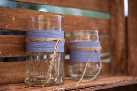 Glass vase in a wooden box. Concept of hand made decor in the country rustic style. Close up Stok Fotoğraf