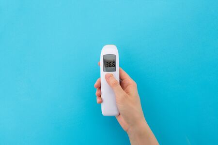 Infrared non-contact thermometer for temperature measurement. The concept of an electronic device to check Your health