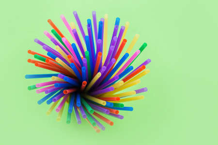 Fireworks or fireworks from a variety of plastic colored straws. Isolated on a green background