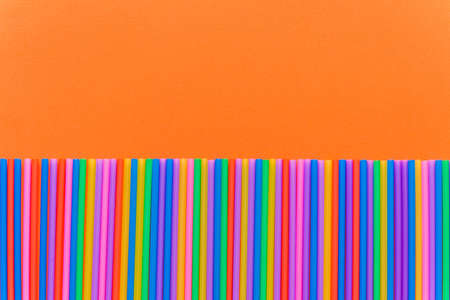 A strip of many plastic colored straws arranged in a row. Isolated Stok Fotoğraf