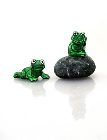 two ceramic frogs hanging out Фото со стока