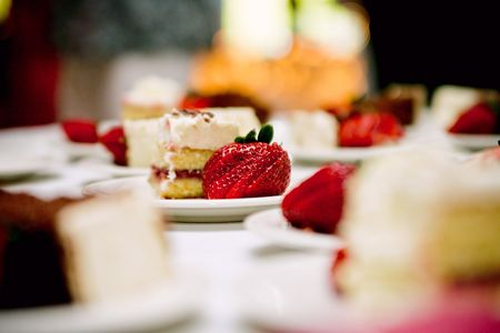 close up of a slice of wedding cake on a plate Stock Photo