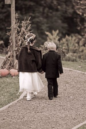 flowergirl and ringbearer boy and girl walking away together